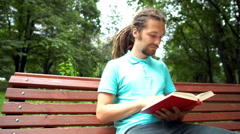 A young man is telling about a book Stock Footage