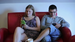 Couple is spending time together with smartphones - stock footage
