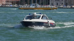 Police boat in the canals of Venice - Carabinieri Stock Footage