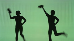 Silhouette of dancing couple with hats Stock Footage