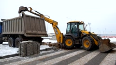 An Excavator And Truck Are Loading Soil Stock Footage