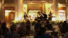 Musicians at the exclusive street cafes on St Mark s Square in Venice Stock Footage