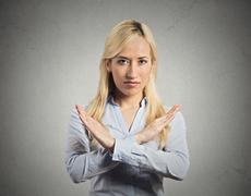 Woman with X gesture asking to cut it out Stock Photos