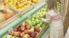 Family makes purchases in the supermarket Stock Footage