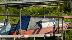 A small fishing boat on the hut Stock Footage