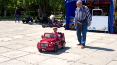 Child drives a ride on car Stock Footage