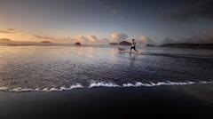 Teen boy jogging on beach, Pacific Coast, Oregon - stock footage