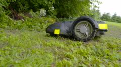 An automower car going along the green grass Stock Footage
