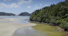 Aerial flying over beach on matapouri beach in northland, new zealand Stock Footage