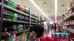 Grocery clerk stocking drink in Walmart store with 4k resolution - stock footage