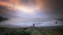 Man hiking trail overlooking the Pacific Ocean, Cape Blanco State Pk, OR Stock Footage