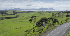 Aerial flying over farm land in Bream Bay, northland, New Zealand Stock Footage