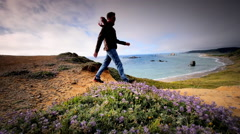 Man hiking trail overlooking the Pacific Ocean, Cape Blanco State Pk, OR - stock footage