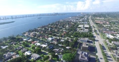 North Palm Beach Lighthouse Dr South Pan Up Crane Down Stock Footage