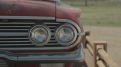 Close up on head lights of abandoned car in Desert Stock Footage