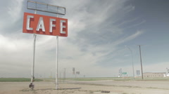 Cafe sign in desert with overcast sky Stock Footage