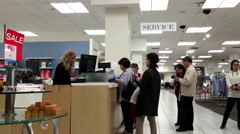 One side of customer line up for paying stuff at service counter Stock Footage