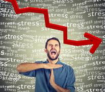 Young man showing time out hand gesture, frustrated screaming to stop stress - stock photo