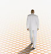 African businessman walking in surreal setting Stock Photos