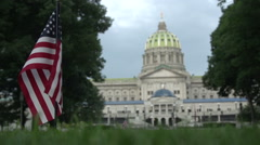 Harrisburg, Pennsylvania - State Capitol Building - Lawn Flag Justified FAR left Stock Footage