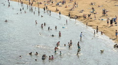 People sunbathing on the crowded sand beach - stock footage