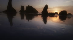 Beach and sunset at low tide, Bandon, OR Stock Footage