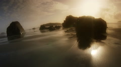 Beach and sunset at low tide, Bandon, OR - stock footage