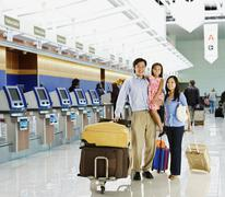 Asian family posing in airport Stock Photos