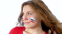 Girl with Russian flag on her face smiling Stock Footage