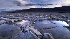 Pools of water after rain in Salt Flats in Death Valley NP, CA Stock Footage