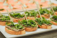 Plate of sandwiches and stuffing on  toothpick baguette, beef  lettuce Stock Photos