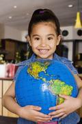 Chinese girl holding globe Stock Photos