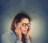 Stressed business woman having headache brain melting into lines question mar Stock Photos