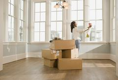 African woman moving house Stock Photos