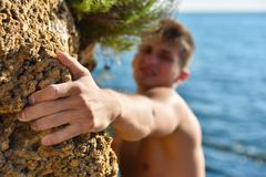Climber making efforts to succeed Stock Photos