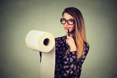 Long list of things to do. Young woman in glasses writing down ideas isolated - stock photo