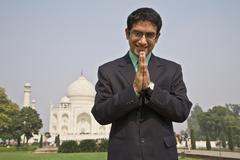 Indian businessman praying at the Taj Mahal Kuvituskuvat