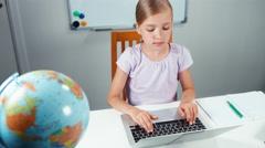 Schoolgirl using laptop in classroom. Top view. Thumb up. OK Stock Footage