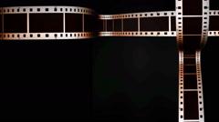 Scrolling filmstrips on black Stock Footage