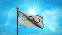 Official olympic flag flutters in slow motion wind against bright blue sky Stock Footage