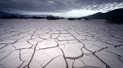 Dry, cracked earth in lake bed, CA - stock footage