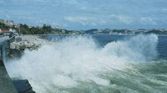 Ocean wave hitting rocks with big splash Stock Footage