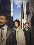 Multi-ethnic businesspeople in urban scene Stock Photos