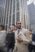 African American businessman holding newspaper Stock Photos