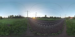 360 VR Passenger train passing by in the country at sunset. Mozhaisk, Russia Stock Footage