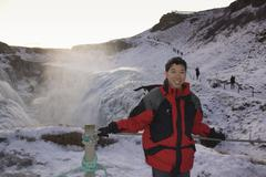 Chinese man standing on remote ice field Stock Photos