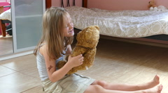 Young angry girl and brown teddy bear.  Stock Footage