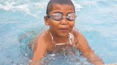 Little Thai boy learning to swim slowmotion Stock Footage
