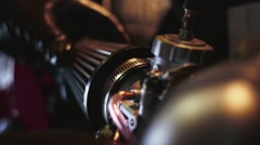 Mechanic fitting carburettor to motorbike Stock Footage