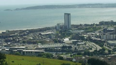 Overview of Swansea city next to sea Stock Footage